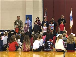 WVES Students standing with friends/family honored as our Veterans.