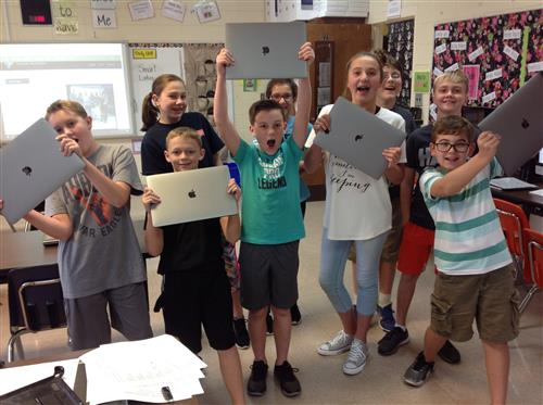 We LOVE our new MacBook Pros!